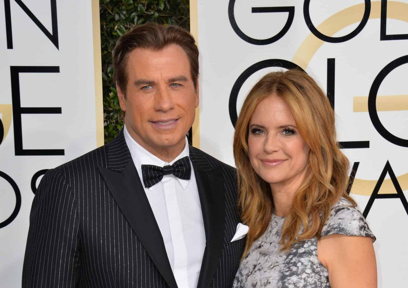 Travolta with a full head of hear appearing with wife Kelly Preston in early 2017