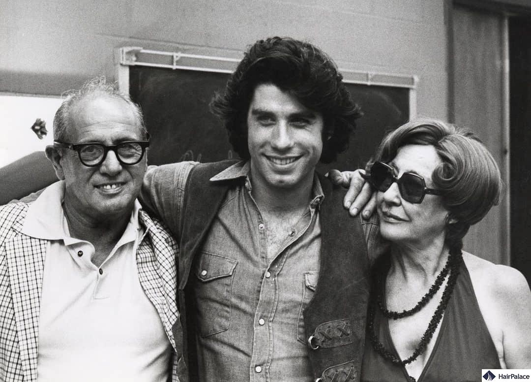 Young John Travolta with his iconic dense hair, pictured with his parents in the late 1970s
