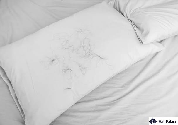 balding sign hairs on pillow